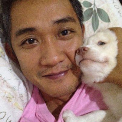 rita's hubby cuddling their pet dog: director fm reyes.