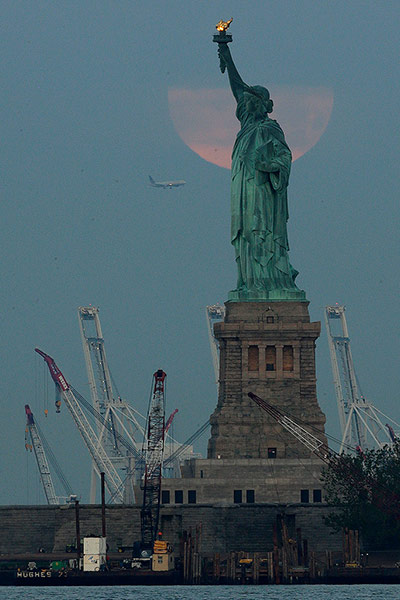 the super moon in New York, at the Statue of Liberty. Photo taken June 23, 2013