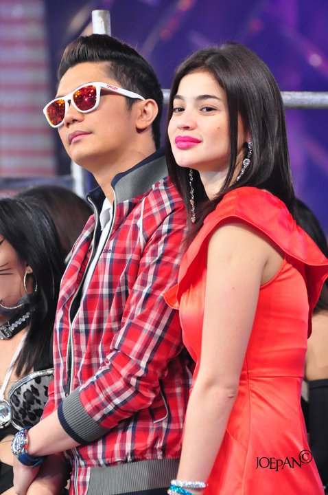 "anne curtis (on the photo with co-host vhong navarro): her lively outfits at her noontime show ""showtime"" at channel 2 is always a delight to see."
