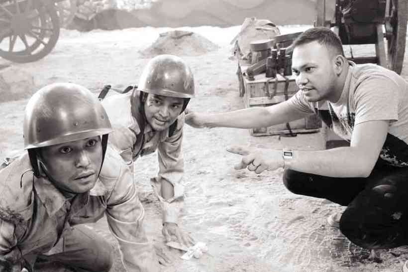 "director adolf alix, jr. instructs actors jason abalos and zanjoe marrudo in one scene in the movie ""death march"""