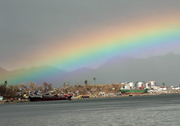 A rainbow is seen over the typhoon devastated city of Tacloban, Leyte island province, Philippines, 19 November 2013. The death toll from Haiyan's destruction has reached at least 3,976 with 1,598 missing and more than four million displaced according to the national disaster relief agency. More than 18,000 were injured. Haiyan slammed into the eastern Philippines on 08 November with record winds of more than 300 kilometers per hour. A storm surge of up to four metres destroyed more than a million houses. EPA/FRANCIS R. MALASIG