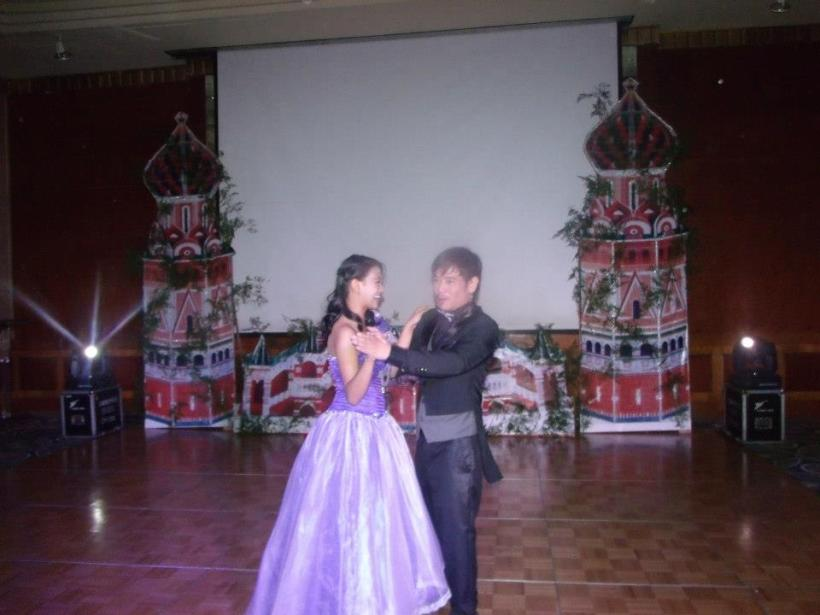 mr. vince tanada and a female stager doing the tradional dance ball at last year's psf christmas ball.