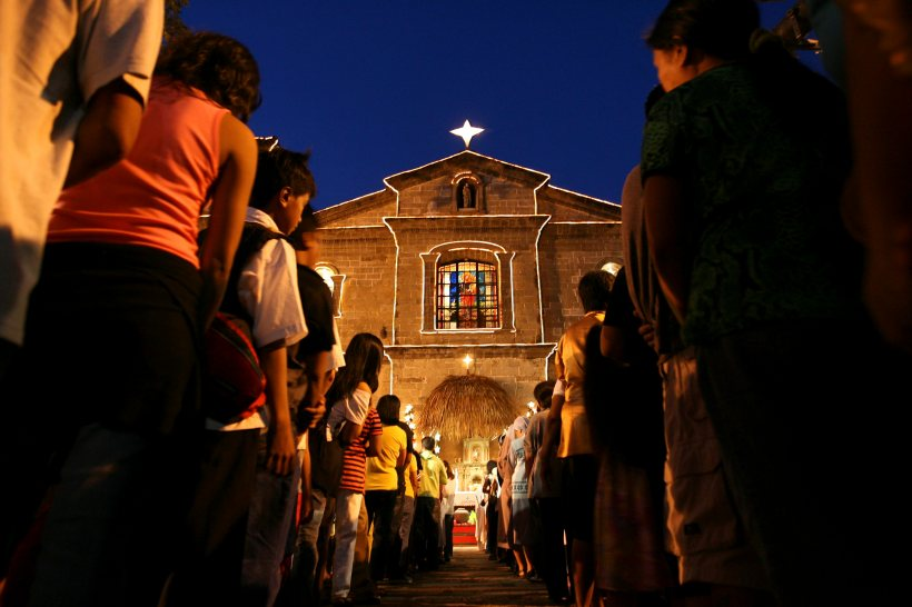 FILIPINOS ATTEND FIRST IN SERIES OF MIDNIGHT MASSES LEADING UP TO CHRISTMAS