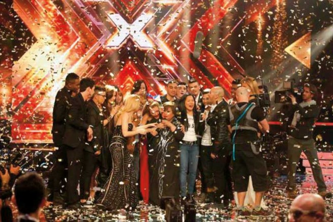 "rose fostanes being congratulated by other contestants at her ""x-factor israel"" win"
