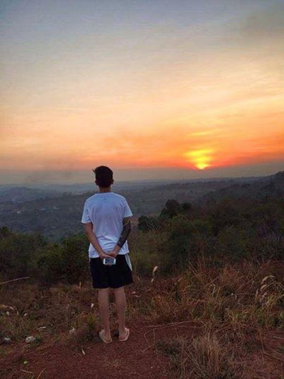 A YOUNG MAN VIEWING A SCENERY COUNTRYSIDE IN GEN. TINIO