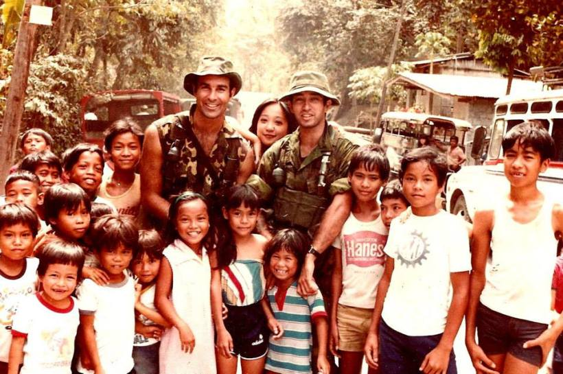 """The girl behind us and between Michael and I, was a local gal in Laguna. Think we were on location near Mt. Makiling and this may have been near UP Los Banos, Laguna. We did not have a chance to make prints for all of the kids."""