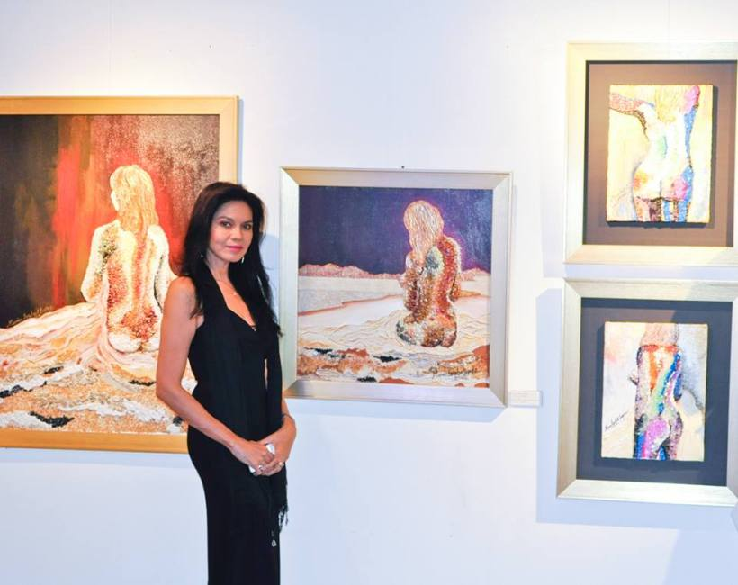 farthest left is the painting done by ms. maribel lopez which skin rejuve owner-prescy valenzuela-yulo bought. the beauty queen and her paintings
