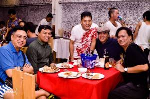 ms. renee garcia, 5th from left, with mr. chikki martin 3rd from left, standing) robert silverio (fourth from left) and other friends of elites family.