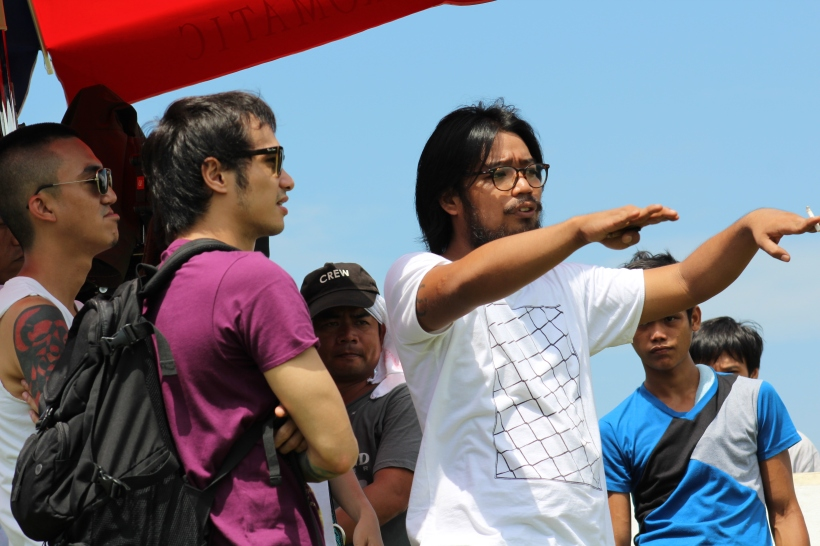 "kean cipriano receives instruction in a shoot of ""hindi sila tatanda"""