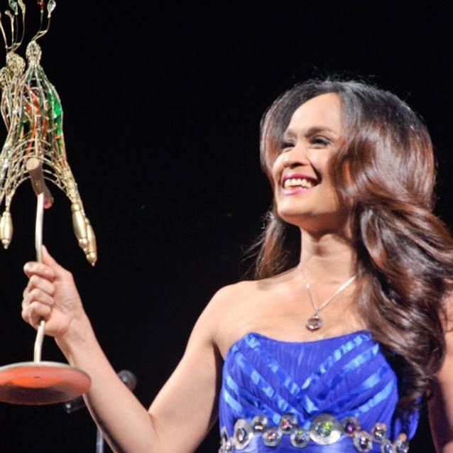 "mimi holding her ""best actor"" trophy at the cinemalaya awards last year"