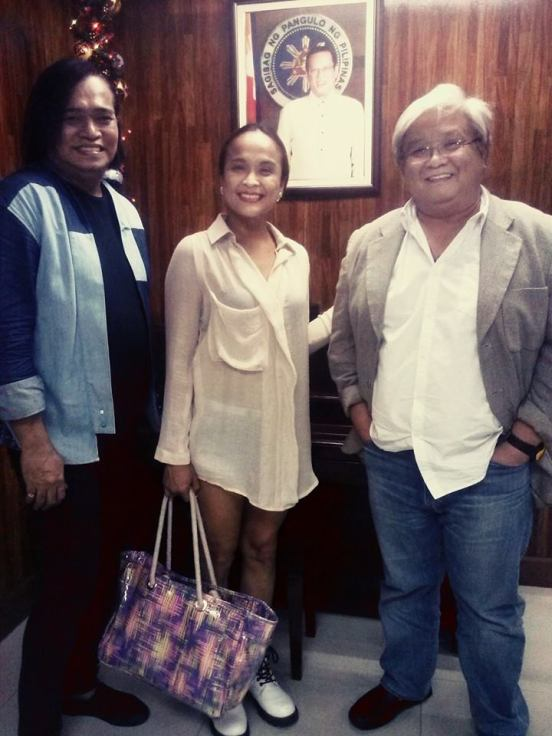 ms. mimi juareza with radio host renee garcia and an official at phil. broadcasting network