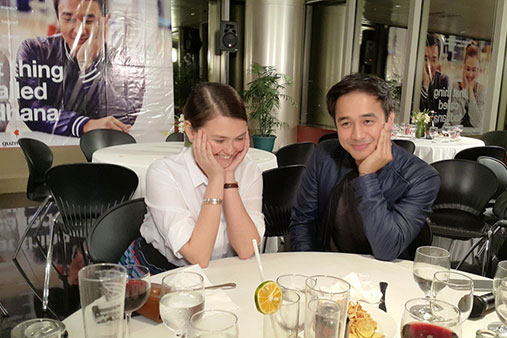 """Angelica Panganiban and JM De Guzman re-enact their pose on the poster of their movie """"That Thing Called Tadhana"""" during the film's victory party last week. Photo: Handout"""