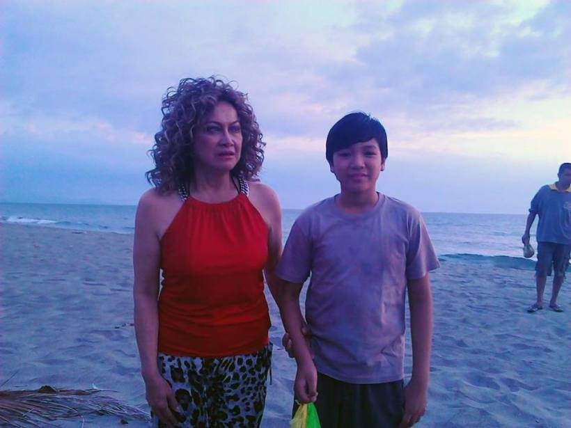 "lou with her co-star in ""butanding"", child actor jerome miles manzano"
