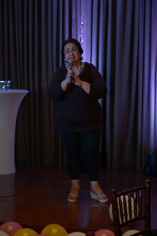 ms. tessie lagman offers a song