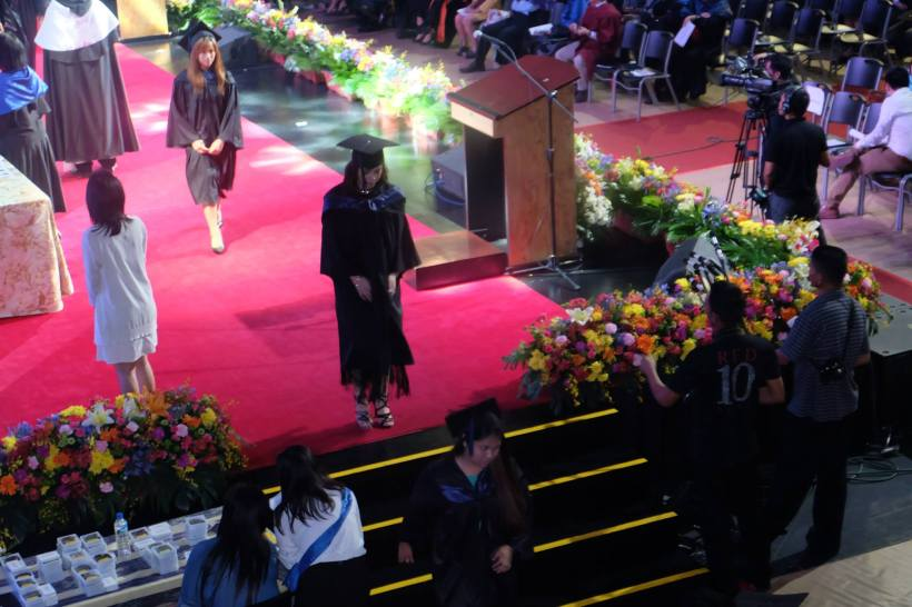 DENZ ON THE STAGE DURING THE GRADUATION CEREMONIES