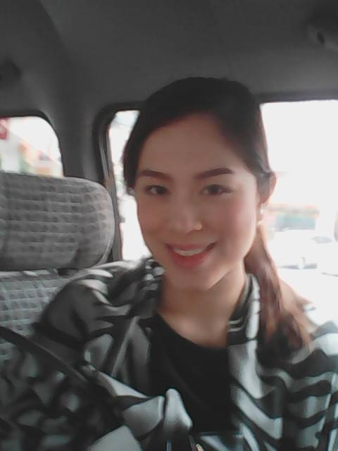 MS. CARLA LIZARDO INSIDE THE VAN OF PTV-4