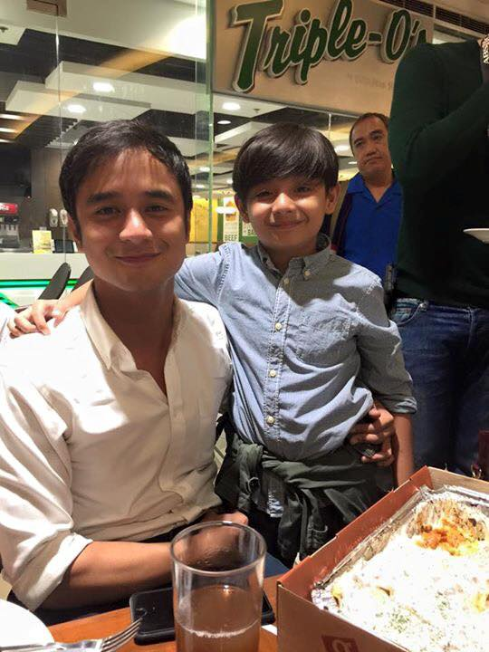 a blogger looks from behind on jm de guzman, carrying little akira