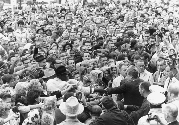 ST-525-8-63 22 November 1963 President Kennedy greets crowd at rally, Ft. Worth, Texas. Photograph by Cecil Stoughton, White House, in the John F. Kennedy Presidential Library and Museum, Boston.