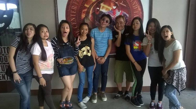 blogger sssip in a wacky shot, together with the acting workshop students of conde performing arts
