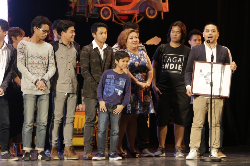 Ramon A.L. Garilao wins the Special Jury award and Best Direction award for the film 'Fish Out of Water' in the short film category. (Photo by Kiko Cabuena)